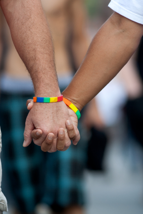 Gay Men Holding Hands with Rainbow Bracelets