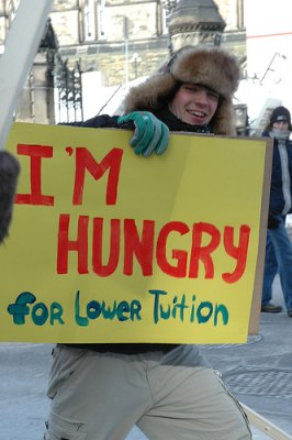 A student protesting to lower tuition costs at his university